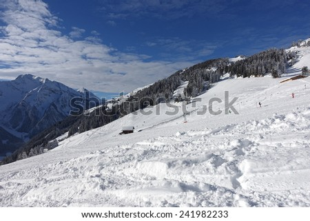 Ski slope and tow lift - stock photo