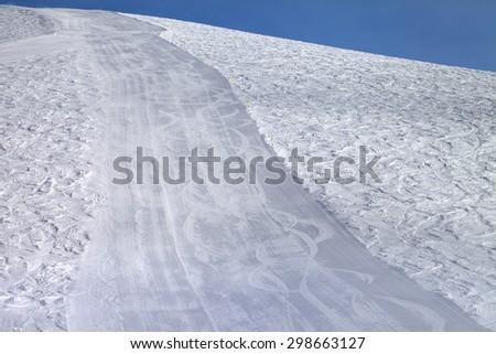 Ski slope at sun evening. Caucasus Mountains. Georgia, ski resort Gudauri. - stock photo
