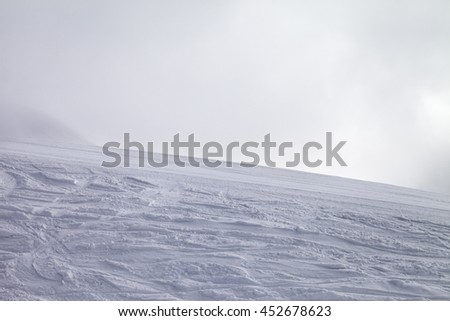 Ski slope for slalom and overcast sky in bad weather. Georgia, ski resort Gudauri. Caucasus Mountains. - stock photo