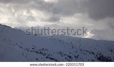 Ski slope in cold weather - stock photo