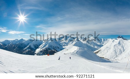 Ski slope in the mountains - stock photo