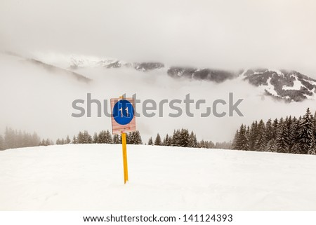 Ski Slope Sign near Megeve in French Alps, France - stock photo