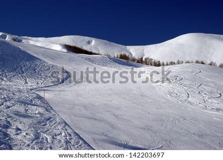 Ski slope to ski resort in Italian Alps - stock photo