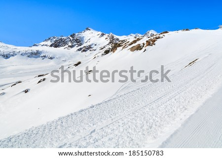 Ski slopes in Pitztal winter mountain resort, Austrian Alps - stock photo