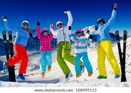Ski, snow  and winter fun - happy family ski team - stock photo