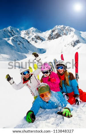 Ski, snow, sun and winter fun -  happy family ski team - stock photo