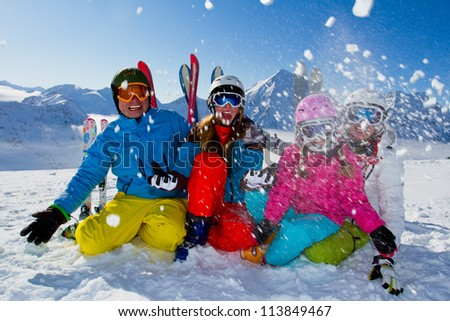Ski, snow, sun and winter fun -  happy family ski team - stock photo