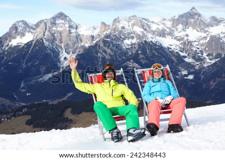 Ski, snow, sun and winter holidays - resting skier in ski resort - stock photo