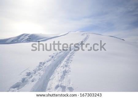 ski touring on the mountain ridge in powder snow  - stock photo