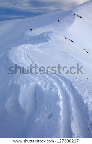 Ski traces left on the snow by two backcountry skiers, Tarcu mountains, Romania - stock photo