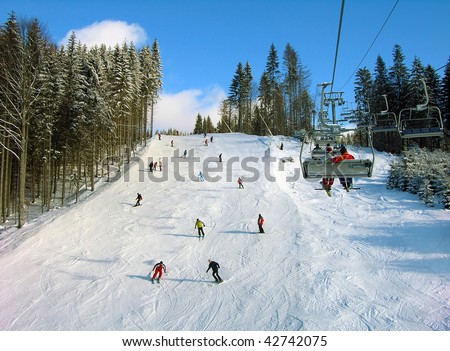 Ski track with chair lift, Bukovel resort, Carpathian mountains, Ukraine - stock photo