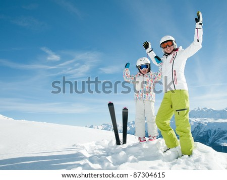Ski vacation - portrait of happy skiers - stock photo