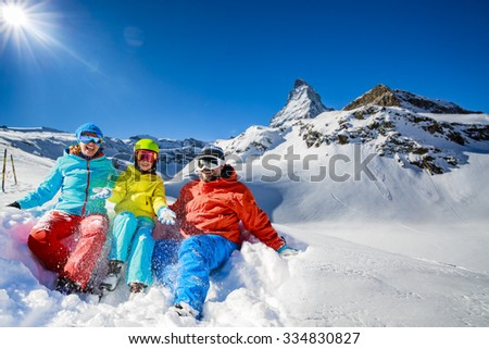 Ski, winter, snow - family enjoying winter vacation in Zermatt, Switzerland - stock photo