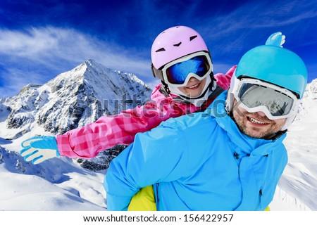 Ski, winter, snow, skiers, sun and fun - family enjoying winter vacations - stock photo