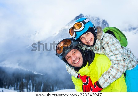 Ski, winter, snow, skiers, sun and fun - Family - father and daughter enjoying winter vacations. - stock photo