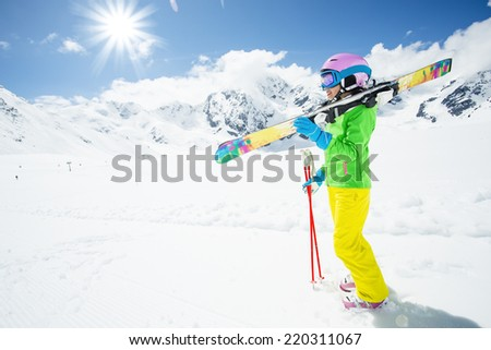Ski, winter sport - lovely skier girl enjoying ski vacation - stock photo