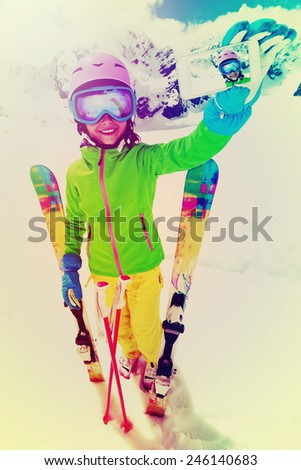 Ski, winter sport - lovely skier girl enjoying ski vacation, filtered - stock photo
