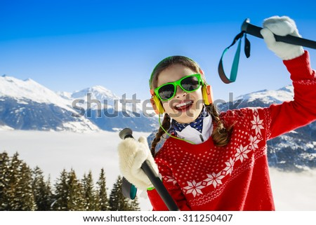 Ski, winter vacation, snow, skier - girl enjoying winter - stock photo