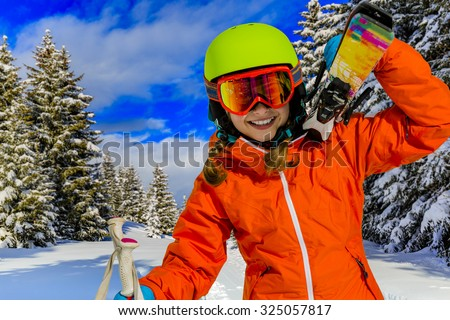 Ski, winter vacation, snow, skier, sun and fun - girl enjoying ski vacations - stock photo