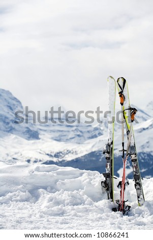 Ski with lots of copy space. Mountains in background - stock photo