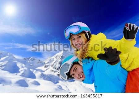 Ski, young couple has fun in mountains  - stock photo