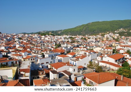 SKIATHOS, GREECE - SEPTEMBER 28, 2012: Looking down onto Skiathos Town on the Greek island of Skiathos. The island was the location for several scenes in the popular 2008 film Mamma Mia. - stock photo