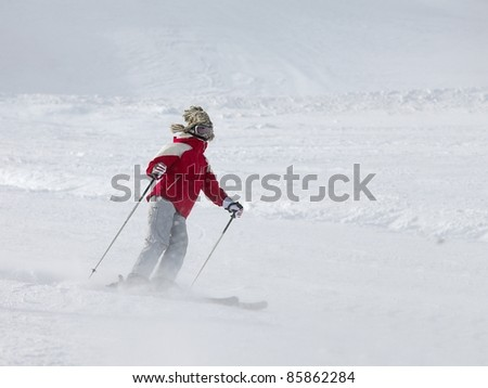 Skier coming down the slope fast - stock photo