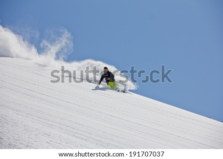 Skier in deep powder, extreme winter freeride - stock photo