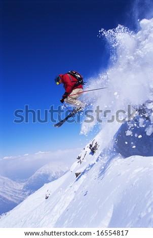 Skier jumping - stock photo