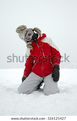 Skier playing in the snow - stock photo