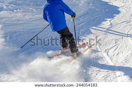 skier slipping on the ski slope - stock photo