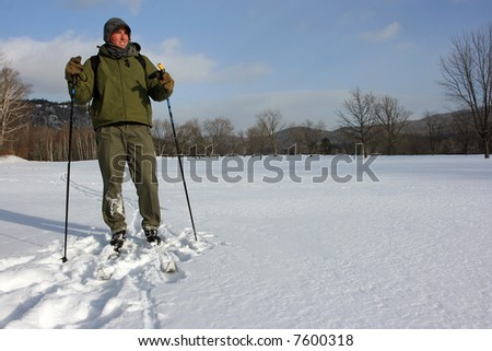 Skier taking a break with winter snow landscape background - stock photo
