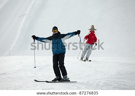 Skiers coming down the track - stock photo