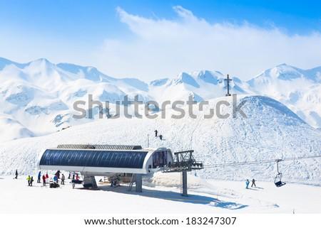 Skiers on ski lift the ski slopes in  Alp mountains, Triglav natural park, Vogel, Bohinj, Slovenia. - stock photo