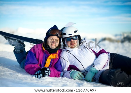 Skiers relaxing - stock photo