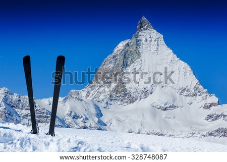 Skiing in the Swiss Alps. Ski, winter season , mountains and ski equipments. Winter vacation  - stock photo