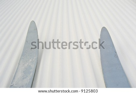 Skiing on groomed snow - stock photo