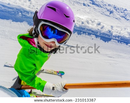 Skiing, ski lift - happy skier on ski lift - stock photo