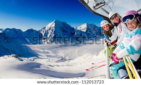 Skiing, ski lift, winter - skiers on ski lift - stock photo