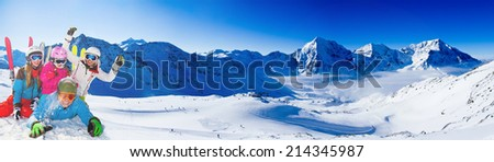 Skiing. Ski, snow sun and fun - family enjoying winter vacation, panorama - stock photo