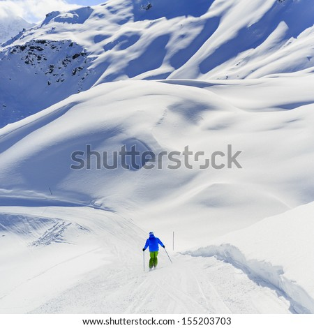 Skiing, Skier, Freeride in fresh powder snow - man skiing downhill - stock photo