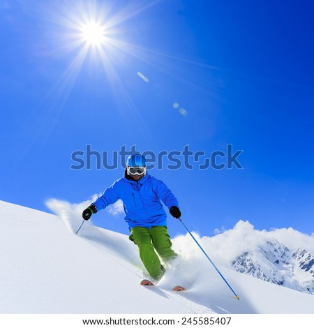 Skiing, Skier, Freeski, Freeride in fresh powder snow - man skiing downhill - stock photo