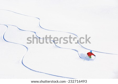 Skiing, Skier, Freeski - freeride, man skiing downhill - stock photo