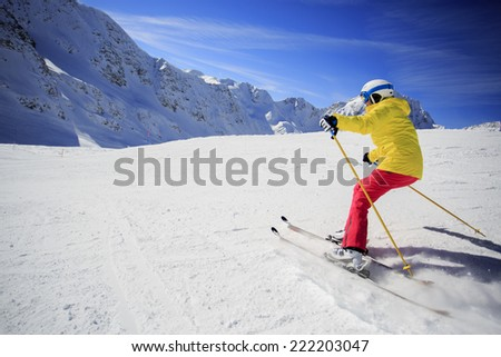 Skiing, skier, winter sport - woman skiing downhill - stock photo
