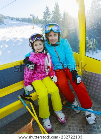 Skiing. Skiers in cable car - stock photo