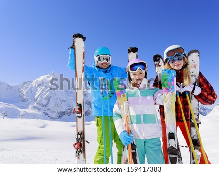 Skiing, skiers, sun and fun - family enjoying winter vacation - stock photo