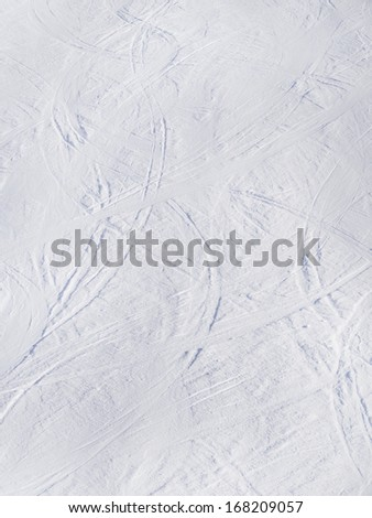 skiing traces on ski slopes from above - stock photo