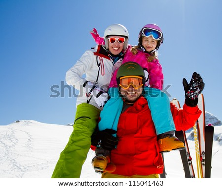 Skiing, winter fun - happy family ski team - stock photo