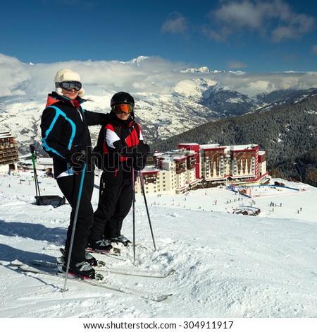 Skiing, winter fun - happy family ski team. France. Travel - stock photo