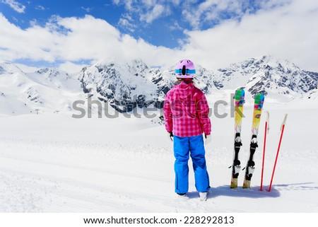 Skiing, winter fun - lovely skier girl enjoying ski vacation - stock photo